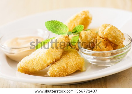 fried cheese with sauce - stock photo