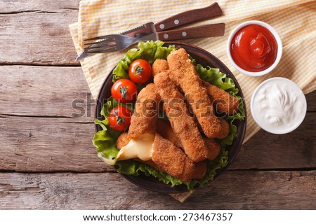 fried cheese with sauce on a plate. horizontal view from above - stock photo