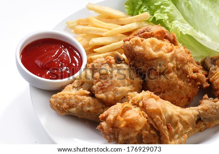 Fried chicken and fries with ketchup - stock photo