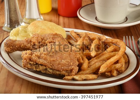Fried chicken dinner with a biscuit and french fries - stock photo