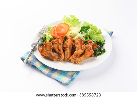 fried chicken drumstick on white plate - stock photo