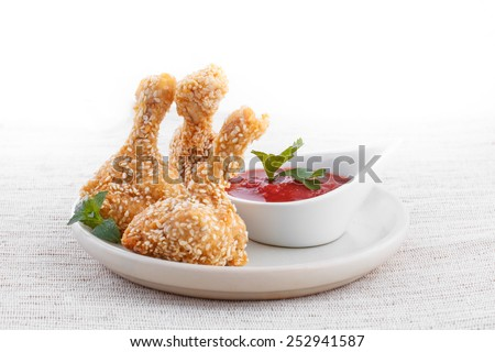 Fried chicken drumsticks with dips - stock photo
