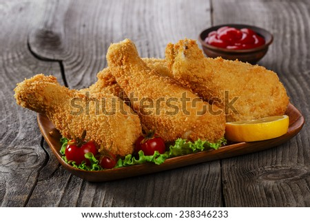 fried chicken leg breaded - stock photo