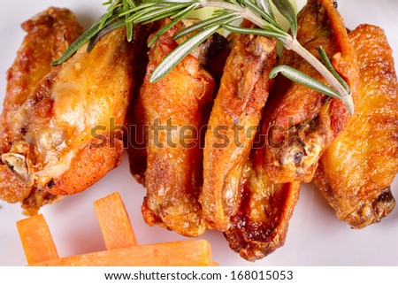 Fried chicken legs and wings - stock photo
