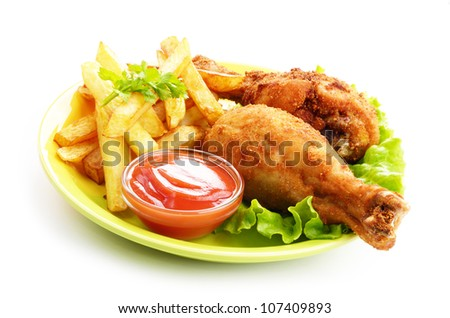 Fried chicken legs with french fries and ketchup over white - stock photo