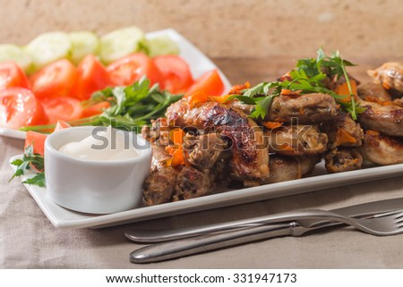 Fried Chicken Necks with vegetables and sauce - stock photo