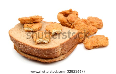 fried chicken nuggets and brown bread slices on white background  - stock photo