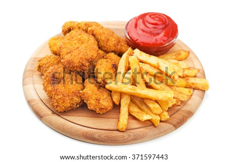 Fried chicken nuggets and  French fries - stock photo