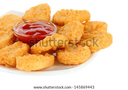 Fried chicken nuggets and sauce isolated on white - stock photo