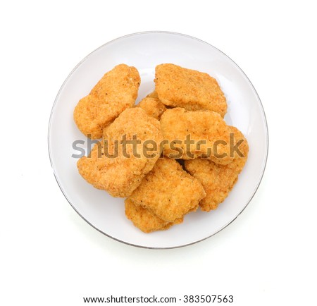 Fried chicken nuggets isolated in plate on white - stock photo