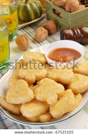 Fried chicken nuggets on a plate - stock photo