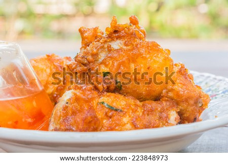 Fried chicken on a white plate - stock photo
