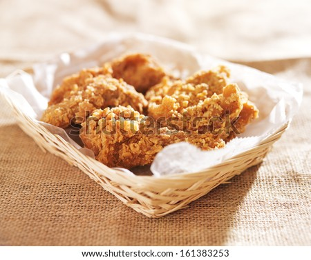 fried chicken pieces in a basket - stock photo