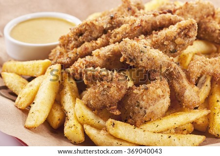 fried chicken wings in batter with french fries - stock photo