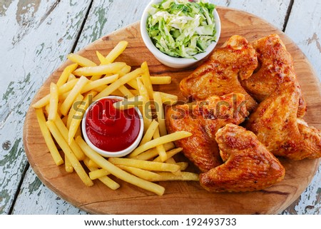fried chicken wings with french fries  - stock photo