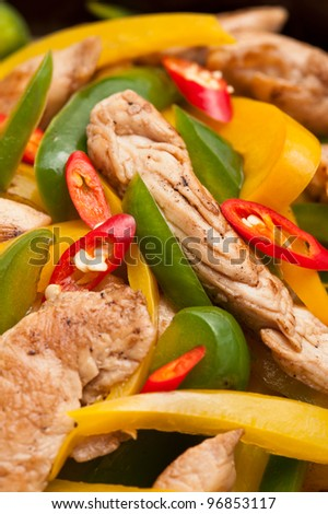 Fried Chicken with capsicum on red table cloth shoot in a studio - stock photo