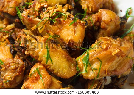 Fried chicken with lemon leaf - stock photo
