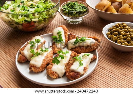 Fried chicken with salad and potatoes - stock photo