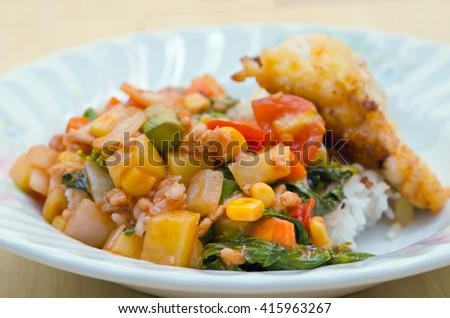 Fried chicken with vegetable tomato sauce and herb â?? thai home made food - stock photo