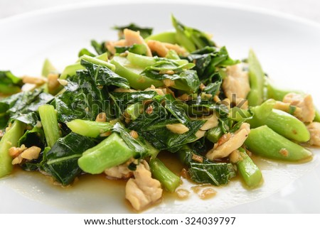Fried Chinese kale With oyster sauce and chicken - stock photo