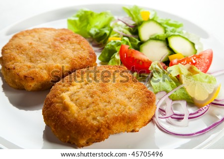 Fried chop pork and vegetable salad - stock photo
