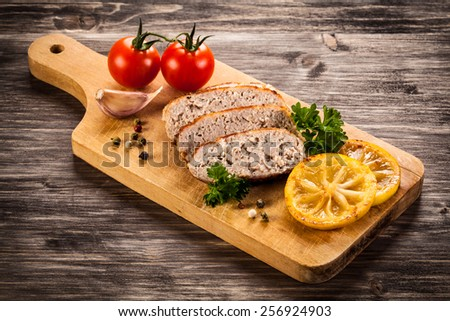 Fried chops and vegetables on cutting board - stock photo