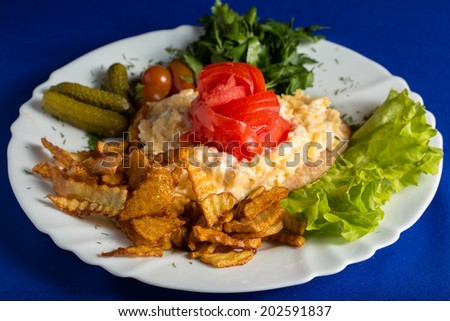 Fried chucken cutlet, French fries and vegetables - stock photo