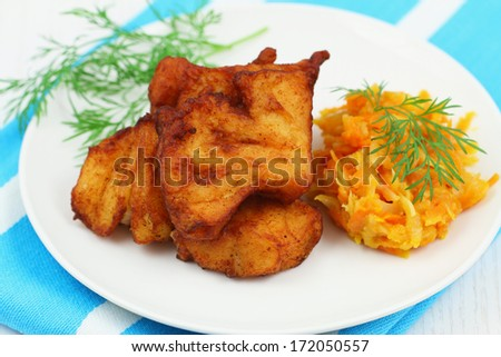 Fried cod pieces with vegetables  - stock photo