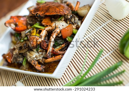 fried crab with black pepper, selective focus - stock photo