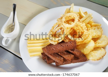 Fried croutons on a plate with sauce - stock photo