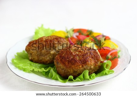 Fried cutlets  and vegetable salad - stock photo