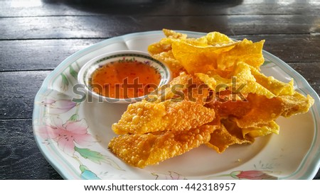 Fried dumplings and sauce - stock photo