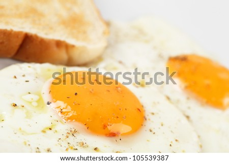 fried egg and bread - stock photo