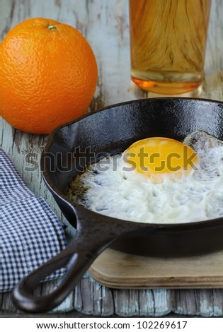 fried egg in a frying pan, a traditional breakfast - stock photo