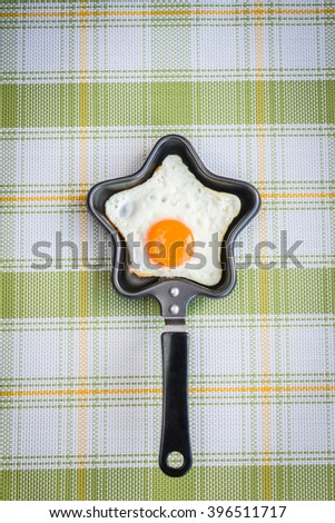 Fried egg in the form of star, top view, flat lay - stock photo