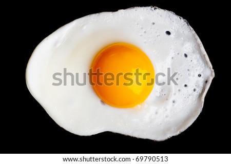 Fried egg isolated on black background - stock photo