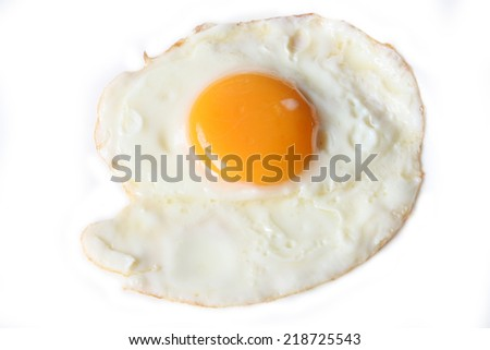 Fried egg isolated with egg white and yolk - stock photo