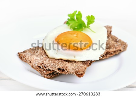 Fried egg on bread, close up view - stock photo