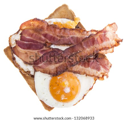 Fried Egg Sandwich with Bacon isolated on white - stock photo