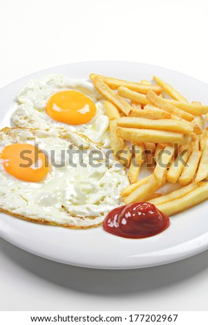 fried eggs and fries - stock photo