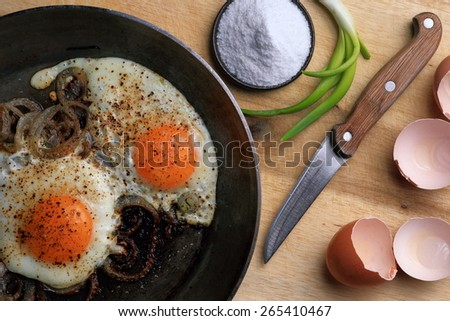 Fried eggs in the frying pan - stock photo