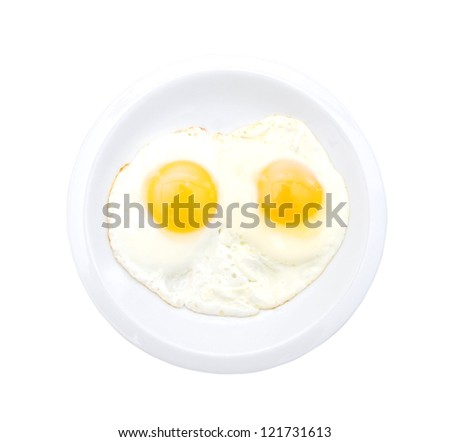 Fried eggs in the place on white - stock photo