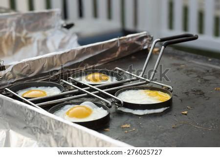 Fried Eggs inside Fry Rings - stock photo