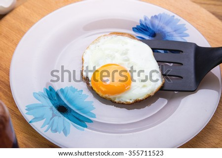 fried eggs on a plate. Plate stands on a wooden table. view from above - stock photo