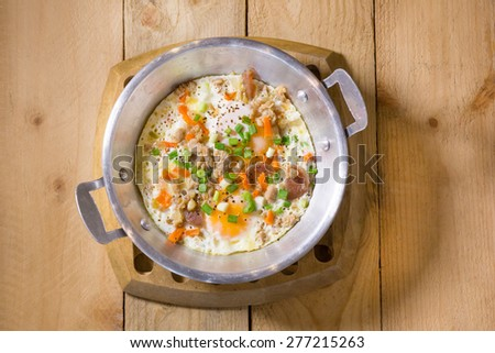 fried eggs pan with minced pork, onion , carrot - stock photo