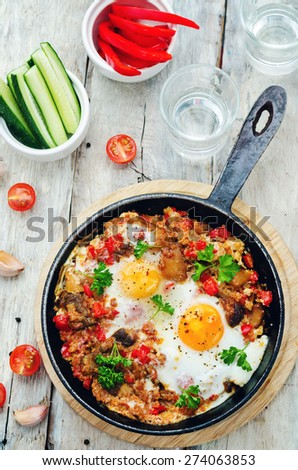 fried eggs with peppers, tomatoes, quinoa and mushrooms. the toning. selective focus - stock photo