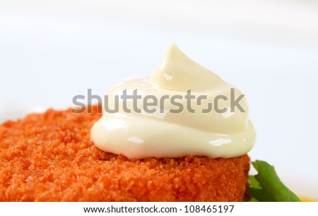 Fried ermine cheese with mayonnaise - stock photo