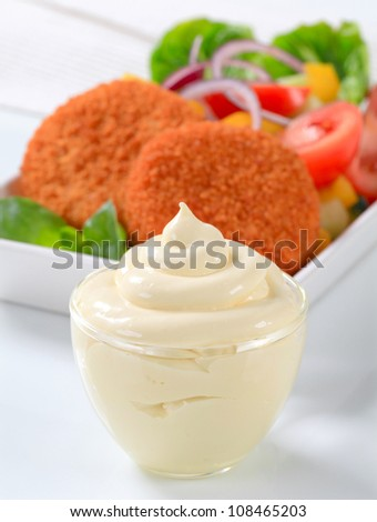 Fried ermine cheese with vegetable salad and mayonnaise - stock photo