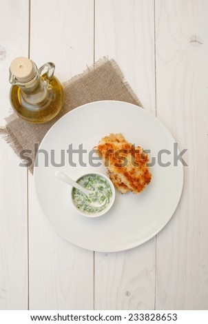 Fried fish cutlets on a plate - stock photo