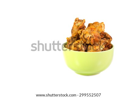 Fried fish sauce marinated chicken drumstick on green cup and sauce isolate on white background - stock photo